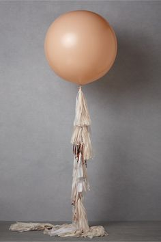 Geronimo! balloon set at BHLDN.  Great look with the long frill made of vintage millinery.  New idea on an overused decoration.