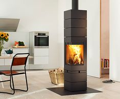 Skantherm's Elements is not only a wood burning stove, but designer furniture for the home. Made of modular units, it evolves and shapes itself around your life Fireplace Design, Fireplace Mantels, Wood Fireplace, Fireplaces, Foyers, Building Design, Building A House, Warehouse Living, Freestanding Fireplace