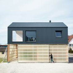 Image 8 of 25 from gallery of House Unimog / Fabian Evers Architecture, Wezel Architektur. Photograph by Sebastian Berger Architecture Résidentielle, Contemporary Architecture, Minimalist Architecture, Small Buildings, Black House, Prefab, Minimalist Home, Detached House, Cladding