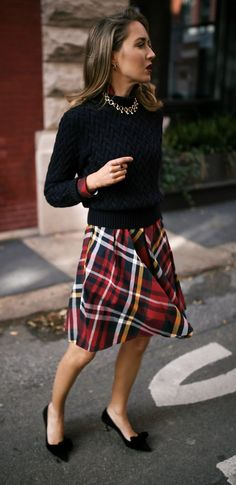 Red tartan plaid shirt dress paired with a navy cable knit sweater, black bow pumps and a brown leather bag {Brooks Brothers, Miu Miu, JW Anderson, holiday style, Christmas style, fashion blogger, street style, holiday party, what to wear to an office hol