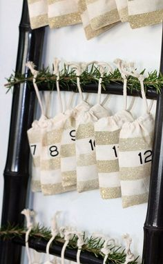 Use Rust-Oleum Glitter Spray Paint to create beautiful DIY Glitter Advent Bags to celebrate the holiday season. Noel Christmas, Christmas Countdown, All Things Christmas, Winter Christmas, Christmas Ideas, Christmas Thoughts, Christmas Tables, Modern Christmas, Scandinavian Christmas