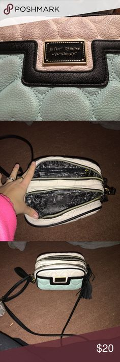 Purse/ satchel Blue and white medium satchel/purse. Holds a lot of things. Has two opening zippers and a zipper on the inside of one of the openings Betsey Johnson Bags Crossbody Bags