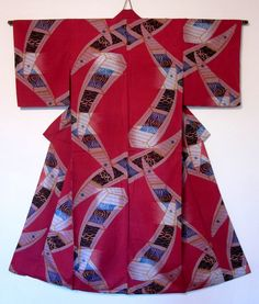 Red meisen kimono with traditional Japanese boat and swirling waters motifs