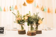 Jar FLowers Twine Log Centrepiece Mint Peach Rustic Barn Wedding http://hannahhallphotography.co.uk/