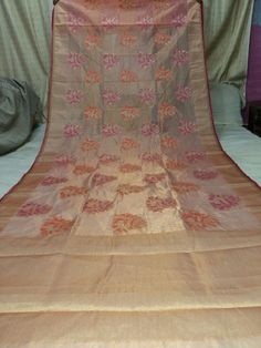 Cream with Pink Kota Tissue Saree with floral mottifs
