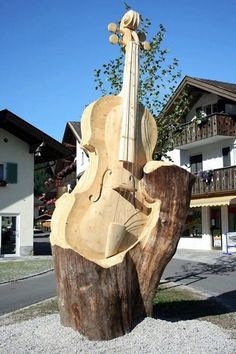 Repurposing Tree Trunks Or Stumps: tree-sculpture cello Chain Saw Art, Tree Carving, Pumpkin Carving, Tree Trunks, Tree Art, Public Art, Belle Photo, Wood Art, Sculpture Art