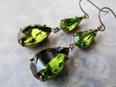 Brilliant sparkling vintage olive green or moss green crystal jewels in pear shaped drops are so sophisticated. I chose 2 pear shaped jewels for extra flash! These would look fantastic on a bridesmaid in a green wedding, as well as any other time you would wear them. Dont miss out on