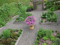 After one season the wood turned from boring beige to graceful gray. I paved the paths between beds with pea gravel, and then enclosed the entire garden with wire mesh attached to pressure-treated posts.