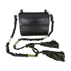 Yves Saint Laurent Haute Couture Crocodile Bag | From a collection of rare vintage handbags and purses at https://www.1stdibs.com/fashion/accessories/handbags-purses/