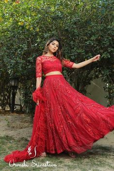 Beautifully crafted red bridal lehenga encrusted with intricate handwork detailing using red sequins and glass beads and adoned with stylish feathers, a gorgeous design for our modern Indian brides! Long Gown Dress, Lehnga Dress, Lehenga Blouse, Lehenga Choli, Indian Lehenga, Red Lehenga, Sharara, Sarees, Wedding Dresses For Girls