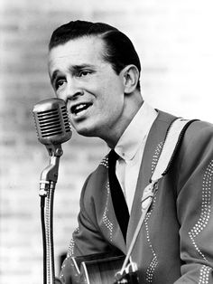 """Bill Anderson 1964--James William """"Bill"""" Anderson III (born November 1, 1937) is an American country music singer, songwriter and television personality. He has been a member in long standing of the weekly Grand Ole Opry radio program and stage performance in Nashville, Tennessee. He has released more than 40 studio albums and has reached No. 1 on the country charts seven times: """"Mama Sang a Song"""" (1962), """"Still"""" (1963), """"I Get the Fever"""" (1966), """"For Loving You"""" (with Jan Howard, 1967), """"My…"""
