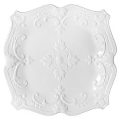 White salad plate with scrolling motifs.  Product: Salad plateColor: WhiteFeatures: Scrolling mo...