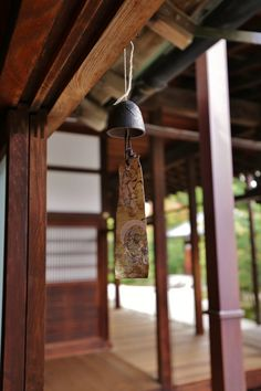 """kuroi-kawaii:   At Kenninji by YOKO    Via Flickr: 風鈴 """"Furin"""" is a wind-bell which is hung under the eaves and makes a sound when receiving a wind. It is made of glass or metal so that it makes cooler-feeling sound. Japanese enjoy the sound and go through a sticky hot summer. The sound is similar with a bell-ringing cricket, a tiny insect which chirps in early autumn."""