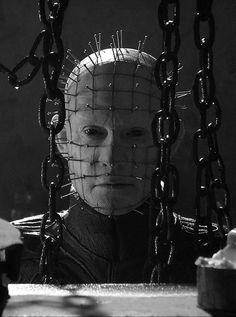 Pin Head from Hellraiser is my favorite villain.  He can sit next to me.