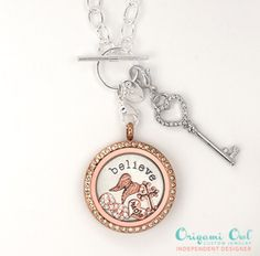 Rose gold and silver with a little bling...pick your own charms and so your locket will say just the right thing.
