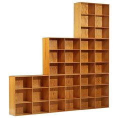 Bookcase by Mogens Koch for Rud. Rasmussens Snedkerier | From a unique collection of antique and modern bookcases at https://www.1stdibs.com/furniture/storage-case-pieces/bookcases/