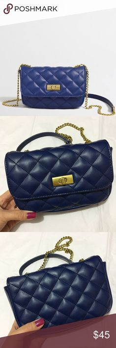 """J CREW FACTORY Cobalt Blue Crossbody Bag NO TRADES. This adorable J Crew Factory cobalt blue crossbody bag features a vegan leather quilted exterior and gold chain strap for a royal dose of luxe. Perfect for the on-the-go gal or the minimalist diva, this mini purse will delight! Approx. measurements: 7"""" x 4.5"""" x 1.75"""" with 21"""" drop. In excellent/ new-like condition! JCrew Factory Bags Crossbody Bags"""