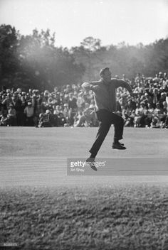 American golder Arnold Palmer leaps into the air in celebration at the Masters Tournament, Augusta, Georgia, 1960.