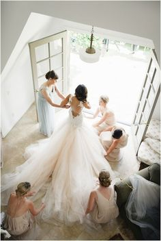 Getting ready. Wedding photography. Bride and bridesmaid photos. Getting dressed photos. Wedding photos.