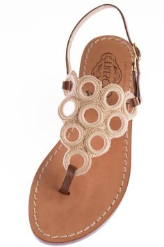 """Serrina is the perfect shoe for walking around all day. Her brown Italian leather straps and crochet top make her the perfect combination of casual and elegant. Our soles are European sizes made in Italy. They are made from Italian leather with a wrapped, wooden heel. Please consult the size guide. If you're a half size, size up. All of our Italian sandals are handmade to order by our cobbler in store. We keep true to the Capri sandal by using nails not glue. We offer a 1/2"""" flat as well as…"""