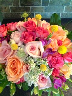 Summer Centerpiece Pink Roses, Coral Roses, Hot Pink Spray Roses, Yellow Craspedia, Purple Freesia, Queen Anne's Lace