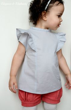 Elegance & Elephants: Ruffle Top Pattern Giveaway, kinda like what I made from her other tute, but I like this better Sewing Patterns Girls, Kids Patterns, Sewing For Kids, Baby Sewing, Clothing Patterns, Sewing Ideas, Sewing Projects, Gerber Baby, Ma Jolie Tribu