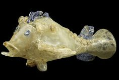 """100 AD Handblown Glass Fish,found in Afghanistan-a 1,900 year old """"glass menagerie"""" was discovered in a storeroom ;this fish is one of the fantastic creatures!"""