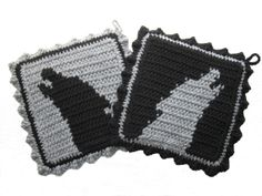 Howling Wolf Pot Holders.  Grey and black potholders with wolf silhouettes.