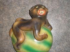 1940s CHALKWARE BLACK FIGURAL BABY ON WATERMELON STRING HOLDER