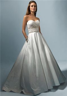 Strapless natural waist taffeta gown with draped sweetheart neckline, dazzling beaded trim, and full circular skirt with pockets and a chapel length train.  Silhouette: A-Line