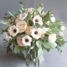 French garden romantic style bridal bouquet... #paperflowers #romanticstyle #bohemianbride #frenchwedding #crepepaperflowers #craftmanship #greenery #paperanemones #paperart