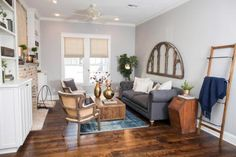 A feature that appealed to the clients immediately was the sizeable living room with tall ceilings. The living area was freed up even further by removing a brick fireplace that had been just inside the front entrance, and relocating it to an exterior wall.