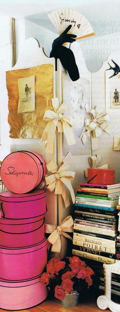The bow festooned, riveted edged cream screen came from the Pierre Balmain salon in Paris…A lovely girlish stack of shocking pink   Schiaparelli round hat boxes… *  Sources:  House and Garden archives