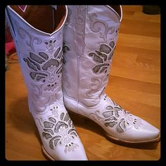 White Cowgirl Boots Pointed toe. Silver sparkly insets and gorgeous design! Beautiful boots! These white boots have never been worn. They just came in the mail and they just were a little too big for me unfortunately! They are in perfect condition of course and have some natural looking light wear spots but they came that way. They are literally new without tags! Wish i didnt have to get rid of them Cowboy Pro Shoes