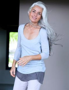 "Caroll McNeill : ""I saw a photo of Yasmina Rossi in a magazine, looking vibrant, energetic, and gloriously gray. Quite suddenly, I realized that...1. just because I was getting older didn't mean I had to be tired, overweight, and out of shape, and…2. gray hair was beautiful, and could really be much more flattering than dying my hair the color it was when I was a teenager. It was a real epiphany!"