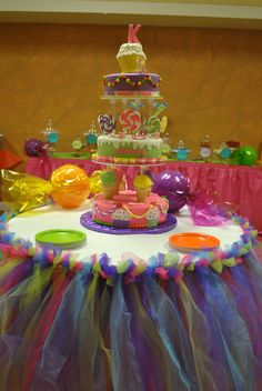 Candyland themed baby shower. Colorful table skirt and candyland themed cake.