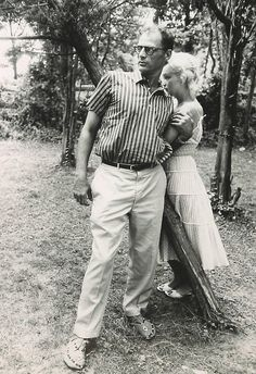 Marilyn and Arthur Miller. She looks so fragile, if she only knew she should've been clinging to the fence for support.