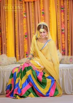 When it comes to mehndi dresses, there are many options to choose from traditional lingerie to experimental modern Haute garments - the choice Bridal Mehndi Dresses, Pakistani Bridal Wear, Pakistani Dresses, Indian Dresses, Indian Outfits, Punjabi Bride, Pakistani Gharara, Pakistani Mehndi Dress, Sharara