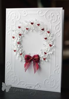White Wreath made with the Martha Stewart Branch punch. Very elegant card.
