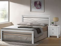 Contemporary white bed frame.  http://www.worldstores.co.uk/p/Monet_White_Bed_Frame.htm