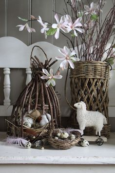 Decoration for spring -- lamb, bird nests, baskets, and flowers