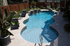 """Pool Town """"Free Form"""" with sundeck and waterfall www.pooltown1.com"""