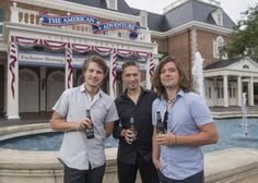 From left, Taylor, Isaac and Zac Hanson introduce their new beer, called Mmmhops, at Epcot in September.
