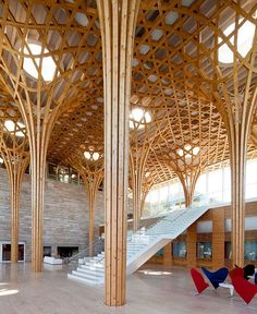 in the main atrium of shigeru ban's golf club in korea features a room of laminated timber columns that form a hexagonal grid and ceiling landscape. see more projects by #shigeruban on #designboom! #architecture image by hiroyuki hirai