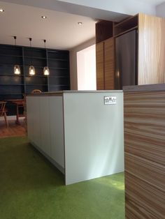 SQ1 Kitchen - Olive Ash, Stainless Steel & Formica, Oak veneered Birch Ply Cabinets