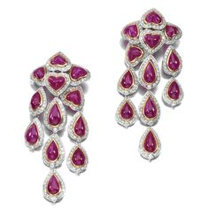 PAIR OF RUBY AND DIAMOND PENDENT EARRINGS, BULGARI. Each designed as a cascade of collet set heart- and pear-shaped cabochons rubies framed by brilliant-cut diamonds, mounted in white and yellow gold, signed Bulgari, case.