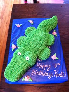 Alligator cake I made for my daughter's 10th birthday!!!  Sheet cake cut in half for body and head.  Bundt cake cut into pieces for legs, tail and eye 'bumps'.  Gum for teeth and claws, lifesavers for eyes.  Wicked fun and easy to do :o)