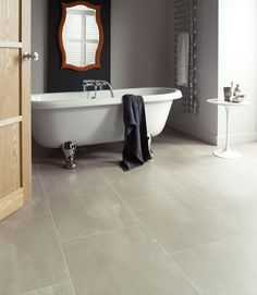Karndean Opus Mico SP211 vinyl flooring brings a understated cloudy design with hints of a marbled pattern, pale grey mottle stone tile effect. The result has the look of the really subtle poured concrete popular in recent interiors trends. The strip displayed between the tiles is AF06 3mm design strip.