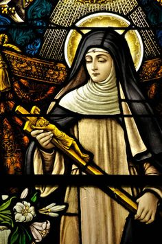 Pinner writes: Stained-glass window of St. Monica holding the crucified Jesus Christ. I suspect this is a different Saint. I will be updating with a comment.