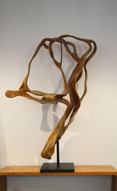 https://www.1stdibs.com/furniture/decorative-objects/sculptures/abstract-sculptures/ribbon-teak-sculpture/id-f_2664662/